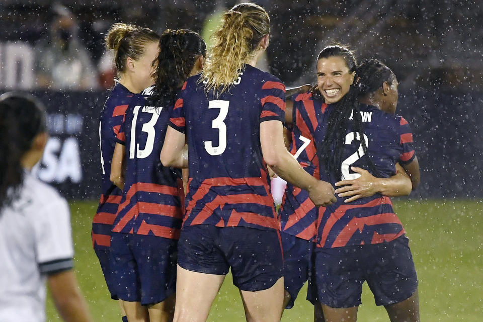 United States' Tobin Heath, second from right, celebrates her goal with teammates during the second half of an international friendly soccer match against Mexico, Thursday, July 1, 2021, in East Hartford, Conn. (AP Photo/Jessica Hill)