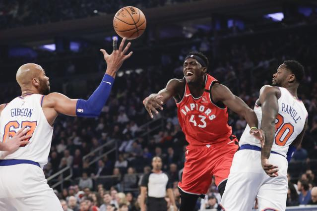 Toronto Raptors' Pascal Siakam (43) loses control of the ball as New York Knicks' Julius Randle (30) and Taj Gibson (67) defend during the first half of an NBA basketball game Friday, Jan. 24, 2020, in New York. (AP Photo/Frank Franklin II)