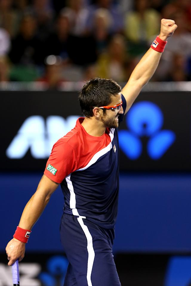 MELBOURNE, AUSTRALIA - JANUARY 14:  Janko Tipsarevic of Serbia celebrates in his first round match against Lleyton Hewitt of Australia during day one of the 2013 Australian Open at Melbourne Park on January 14, 2013 in Melbourne, Australia.  (Photo by Marianna Massey/Getty Images)