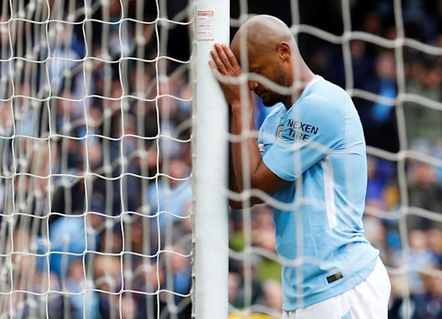 "Soccer Football - Premier League - Manchester City v Swansea City - Etihad Stadium, Manchester, Britain - April 22, 2018 Manchester City's Vincent Kompany reacts after a missed chance REUTERS/Phil Noble EDITORIAL USE ONLY. No use with unauthorized audio, video, data, fixture lists, club/league logos or ""live"" services. Online in-match use limited to 75 images, no video emulation. No use in betting, games or single club/league/player publications. Please contact your account representative for further details."