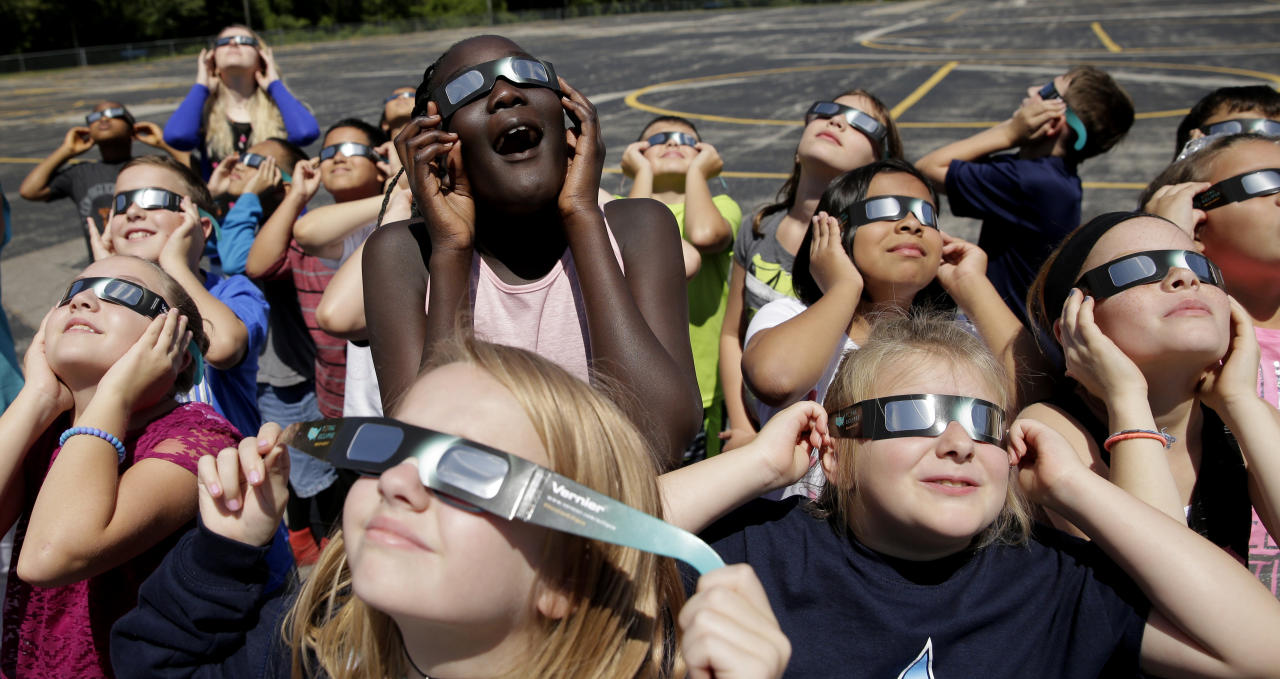 <p>In this photo taken Friday, Aug. 18, 2017, fourth graders at Clardy Elementary School in Kansas City, Mo., practice the proper use of their eclipse glasses in anticipation of Monday's solar eclipse. (Photo: Charlie Riedel/AP) </p>