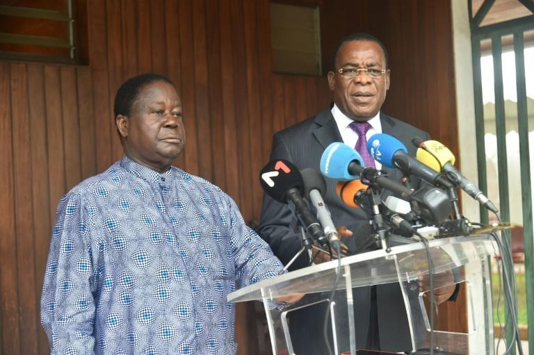 Ivorian opposition leaders Henri Konan Bedie (L) and Pascal Affi N'Guessan (R) had called for a boycott