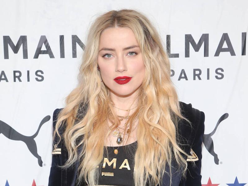 Amber Heard packs on PDA with cinematographer girlfriend