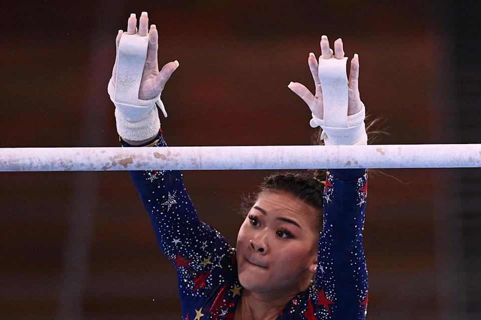 <p>USA's Grace Mc Callum competes in the uneven bars event of the artistic gymnastics women's qualification during the Tokyo 2020 Olympic Games at the Ariake Gymnastics Centre in Tokyo on July 25, 2021. (Photo by Martin BUREAU / AFP) (Photo by MARTIN BUREAU/AFP via Getty Images)</p>