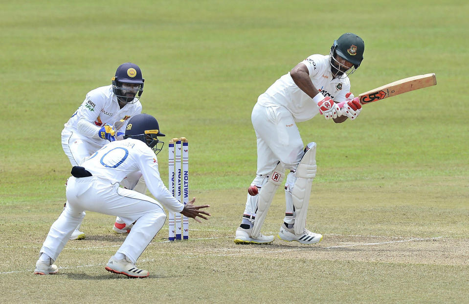 Bangladesh's Tamim Iqbal, right, plays a shot during the third day of the second cricket test match between Sri Lanka and Bangladesh in Pallekele, Sri Lanka, Sunday, May 01, 2021.( AP Photo/Sameera Peiris)