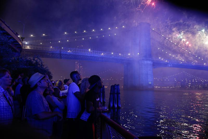 People watch fireworks light up the Brooklyn Bridge during the annual Macy's fireworks show on the East River from Manhattan July 4, 2019 in New York City. This is the 43rd annual July 4 display by the retailer. (Photo: Kena Betancur/Getty Images)