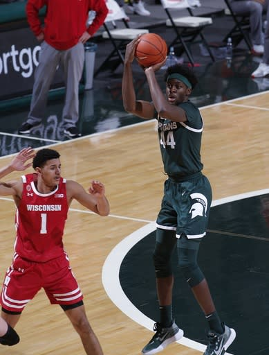 Michigan State's Gabe Brown, right, shoots over Wisconsin's Jonathan Davis (1) during the second half of an NCAA college basketball game, Friday, Dec. 25, 2020, in East Lansing, Mich. Wisconsin won 85-76. (AP Photo/Al Goldis)