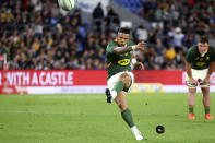 South Africa's Elton Jantjies kicks a late penalty to give the Springboks a win over New Zealand during their Rugby Championship test match on the Gold Coast, Australia, Saturday, Oct. 2, 2021. (AP Photo/Tertius Pickard)