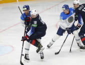 Kazakhstan's Dmitri Shevchenko, left, and Jack Drury of the US in action during the Ice Hockey World Championship group B match between United States and Kazakhstan at the Arena in Riga, Latvia, Tuesday, May 25, 2021. (AP Photo/Sergei Grits)