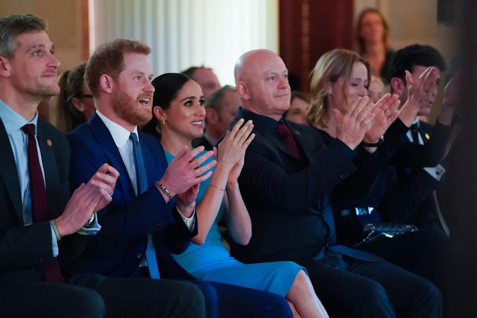 The Duke and Duchess of Sussex cheer during a marriage proposal at the Endeavour Fund Awards at Mansion House in London.