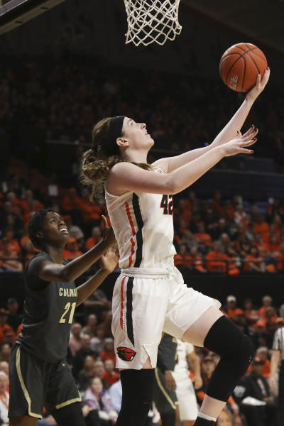 Oregon State's Kennedy Brown (42) drives to the basket past Colorado's Mya Hollingshed (21) during the first half of an NCAA college basketball game in Corvallis, Ore., Sunday, Jan. 5, 2020. (AP Photo/Amanda Loman)