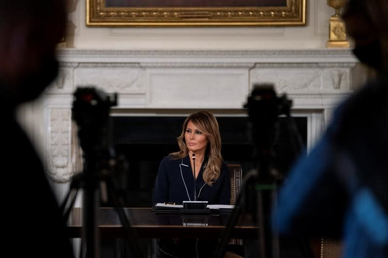 Melania steals spotlight as Trump flexes executive muscles for political show