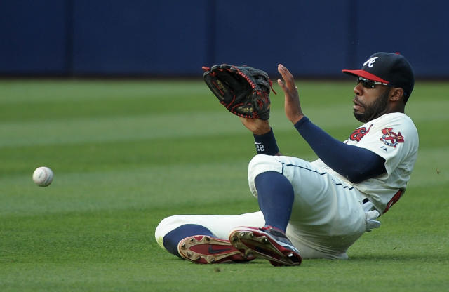 Atlanta Braves right fielder Jason Heyward can't field the hit by San Francisco Giants' Hunter Pence which scores a run during the third inning of their baseball game at Turner Field, Saturday, June 15, 2013, in Atlanta. (AP Photo/David Tulis)