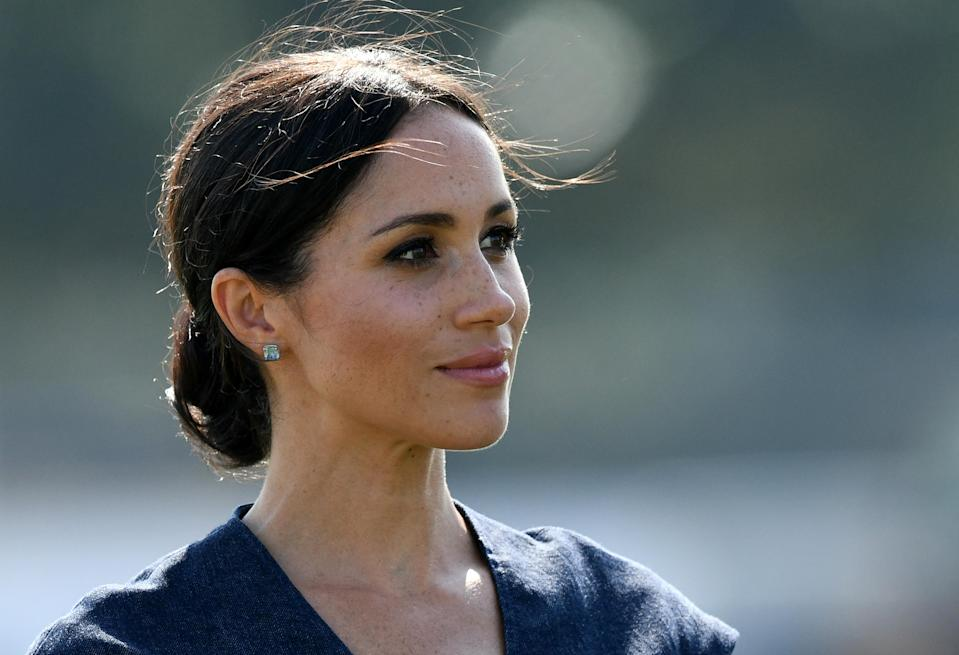 One royal expert has predicted we could see the Duchess opt for a bun should she be expecting [Photo: Getty]