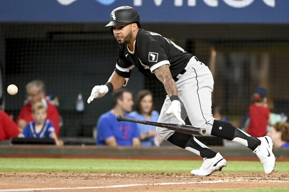 Chicago White Sox's Leury Garcia bunts for a single in the fourth inning during a baseball game against the Texas Rangers in Arlington Texas, Sunday, Sept. 19, 2021. (AP Photo/Matt Strasen)