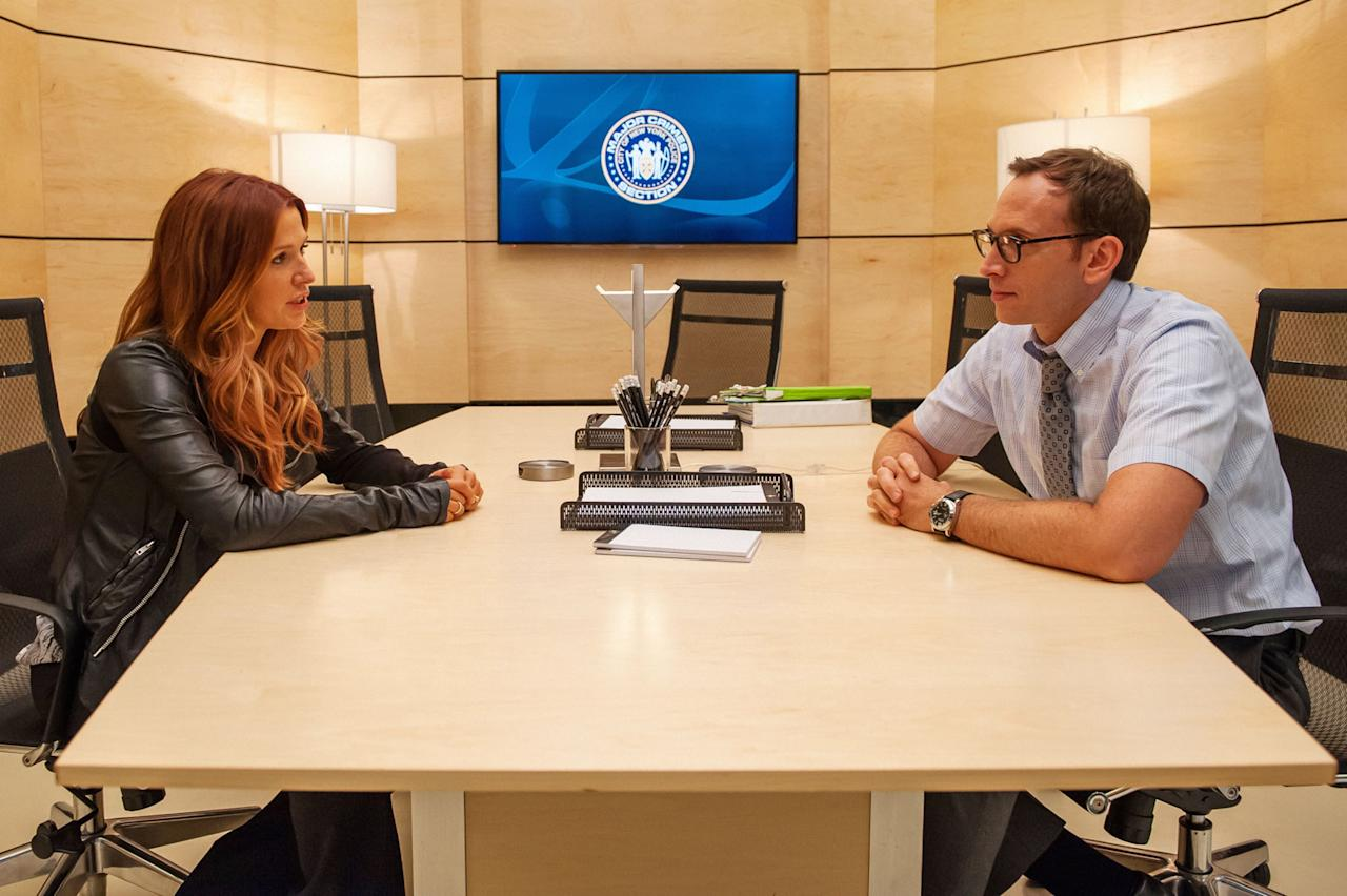 "Carrie (Poppy Montgomery) speaks with Dale Parsons (Stephen Kunken), who shares her unique memory abilities, in hopes that he has information which can solve the murder of the scientist who helped them understand their memories, in the ""Unforgettable"" Season 2 episode, ""Memory Kings."""