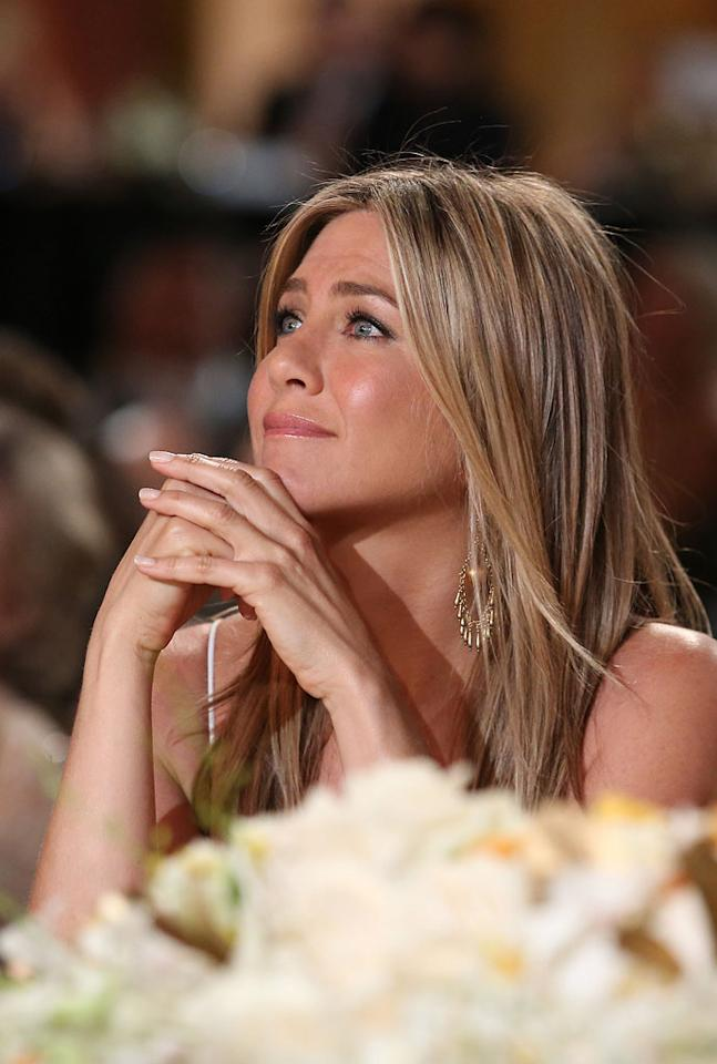 "Jennifer Aniston is sporting a new ""huge diamond engagement ring,"" says <i>X17Online.</i> The site reveals Justin Theroux ""popped the question"" while they were in Paris, where they recently went ""to scout out potential wedding locations."" For details on the ring and how he proposed, as well as when Theroux and Aniston will tie the knot, click over to <a target=""_blank"" href=""http://www.gossipcop.com/jennifer-aniston-diamond-engagement-ring-photo-2012-justin-theroux-pics/"">Gossip Cop</a>."