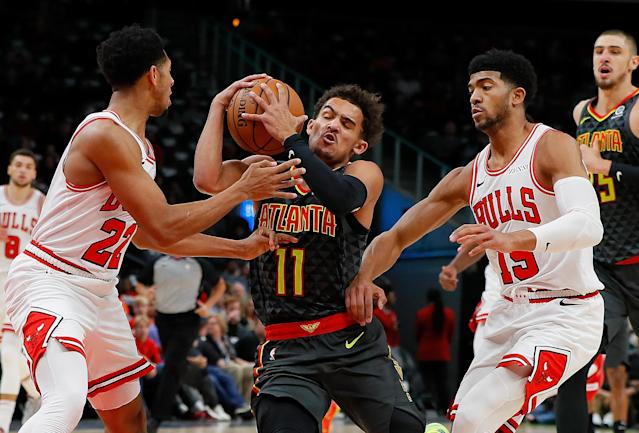ATLANTA, GA - OCTOBER 27: Trae Young #11 of the Atlanta Hawks attempts to drive between Cameron Payne #22 and Chandler Hutchison #15 of the Chicago Bulls at State Farm Arena on October 27, 2018 in Atlanta, Georgia. (Photo by Kevin C. Cox/Getty Images)