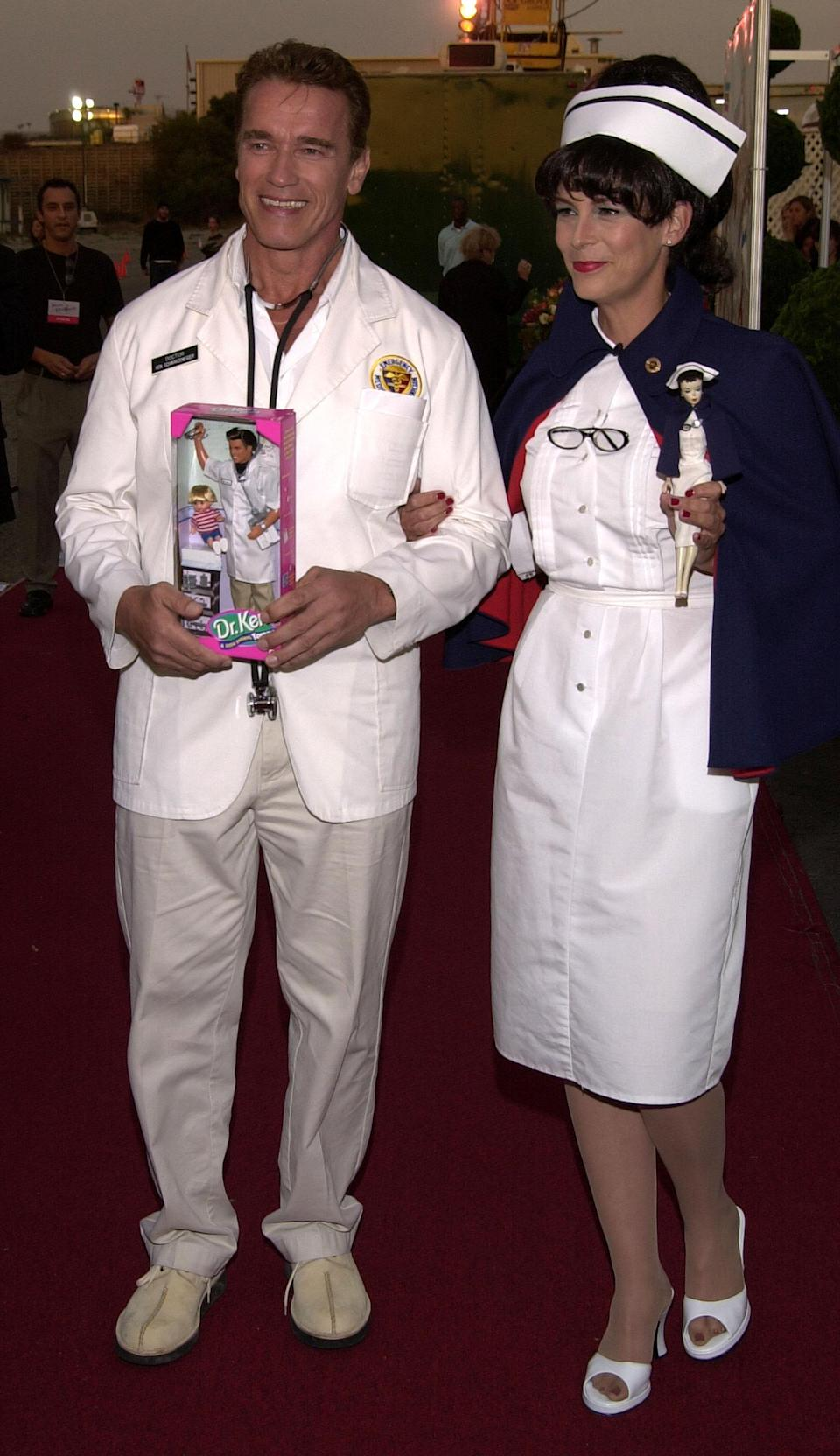 <p>Arnold Schwarzenegger and Jamie Lee Curtis arrive at the 8th Annual Dream Halloween, a fundraising event for children affected by AIDS October 27, 2001 in Santa Monica, CA. (Photo by Sebastian Artz/Getty Images) </p>