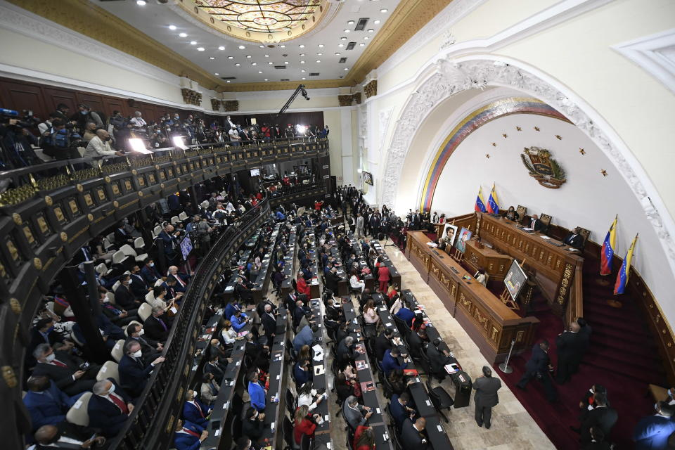 Incoming lawmakers members fill the chamber of the National Assembly during the year's first session in Caracas, Venezuela, Tuesday, Jan. 5, 2021. The ruling socialist party assumed the leadership of Venezuela's congress on Tuesday, the last institution in the country it didn't already control. (AP Photo/Matias Delacroix)