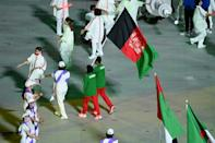 Afghanistan's Hossain Rasouli and Zakia Khudadadi carried their country's flag at the Paralympic closing ceremony (AFP/Charly TRIBALLEAU)