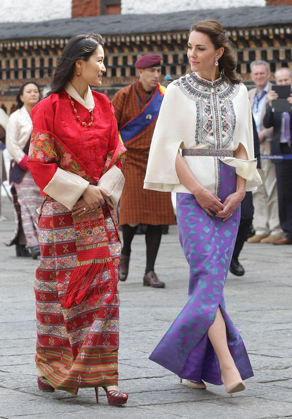 <p>The Queen (photographed here with the Duchess of Cambridge) often sports traditional clothing, known for their bright colors and intricate patterns. </p>