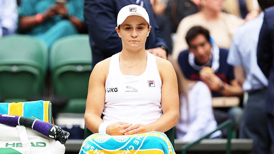 Ash Barty (pictured) sits down between games at Wimbledon.