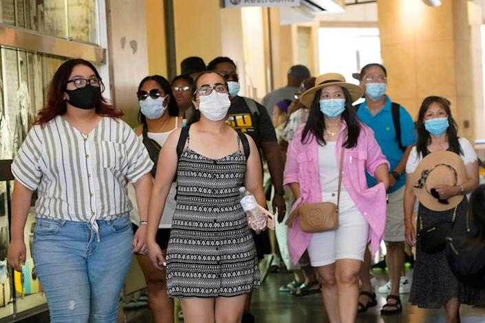 Visitors wear masks in a shopping district in Hollywood on July 1. Coronavirus cases jumped 500% in Los Angeles County over the past month, and health officials warned July 13 that the especially contagious delta variant spread rapidly among California's unvaccinated population.