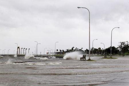 Water floods an area outside the levee system along the shore of Lake Pontchartrain as tropical storm Isaac approaches New Orleans