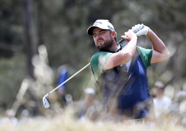 Australia's Marc Leishman hits an approach shot during the World Cup of Golf in Melbourne, Australia, Sunday, Nov. 25, 2018. (AP Photo/Andy Brownbill)