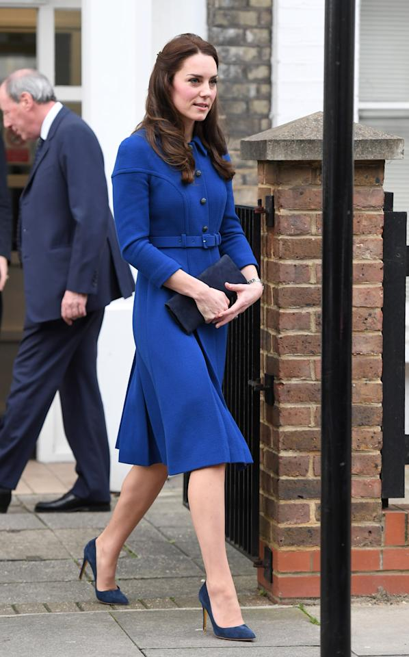 "<p>The Duchess stepped out on January 11th for an official visit to the Anna Freud Centre. As always, she was positively prim, opting for a belted blue coat dress from <a rel=""nofollow"" href=""http://www.eponinelondon.com/aw-16#/1203/"">Eponine London</a>. She decided to go the matchy route this time, slipping into a pair of blue suede shoes (which you'd <i>better not</i> step on!) from Rupert Sanderson. <i>(Photo: Getty Images)</i></p>"