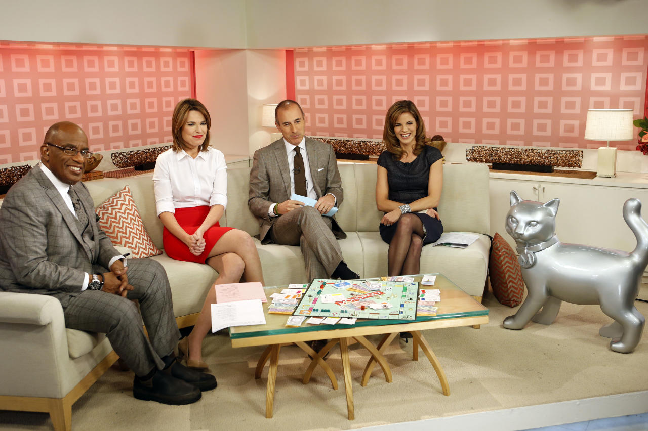 IMAGE DISTRIBUTED FOR HASBRO - Following a worldwide online fan vote, NBC's TODAY Show hosts, from left, Al Roker, Savannah Guthrie, Matt Lauer and Natalie Morales unveil the MONOPOLY game's newest addition - the cat token, on Wednesday, Feb. 6, 2013, in New York. The cat replaces the iron token in the classic game. (Photo by Jason DeCrow/Invision for Hasbro/AP Images)