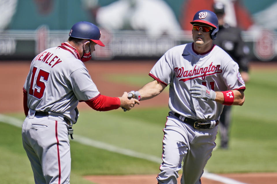 Washington Nationals' Ryan Zimmerman is congratulated by third base coach Bob Henley (15) after hitting a two-run home run during the third inning of a baseball game against the St. Louis Cardinals Wednesday, April 14, 2021, in St. Louis. (AP Photo/Jeff Roberson)