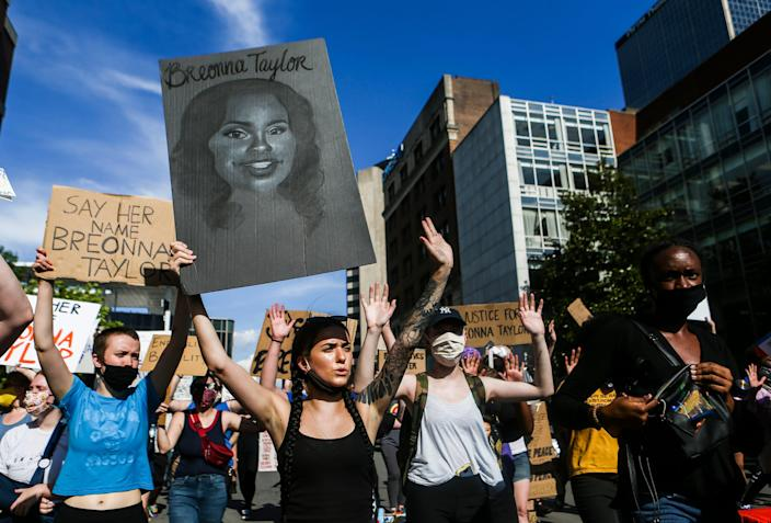 Demonstrators take to the streets of Louisville, Ky., on June 5 to protest the death of EMT Breonna Taylor, who was shot eight times by police during a raid. The officers involved have not been fired.