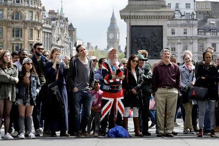 A man wearing a Union Flag outfit watches displays (not seen) in Trafalgar Square in London, Britain April 23, 2017.  REUTERS/Kevin Coombs