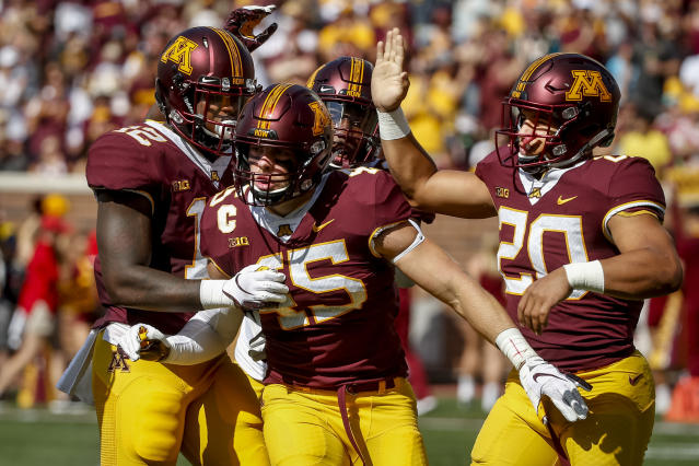 FILE - In this Sept. 15, 2018, file photo, Minnesota linebacker Carter Coughlin (45) celebrates his sack against Miami (Ohio) with Tai'yon Devers (12) and Julian Huff (20) in the first half of an NCAA college football game in Minneapolis. Purdue needs one more win to become bowl eligible, but the Boilermakers are chasing more than that, still with an outside chance at winning the Big Ten West Division, where Minnesota sits at the bottom thanks to a reeling defense. (AP Photo/Bruce Kluckhohn, File)