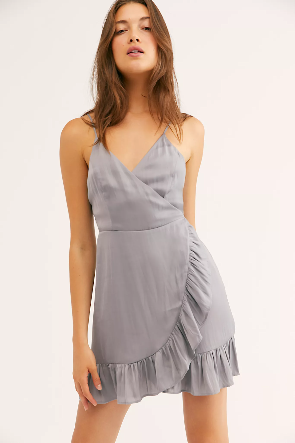 "<br><br><strong>Intimately</strong> All My Love Shine Wrap Slip, $, available at <a href=""https://go.skimresources.com/?id=30283X879131&url=https%3A%2F%2Fwww.freepeople.com%2Fshop%2Fall-my-love-shine-wrap-slip"" rel=""nofollow noopener"" target=""_blank"" data-ylk=""slk:Free People"" class=""link rapid-noclick-resp"">Free People</a>"