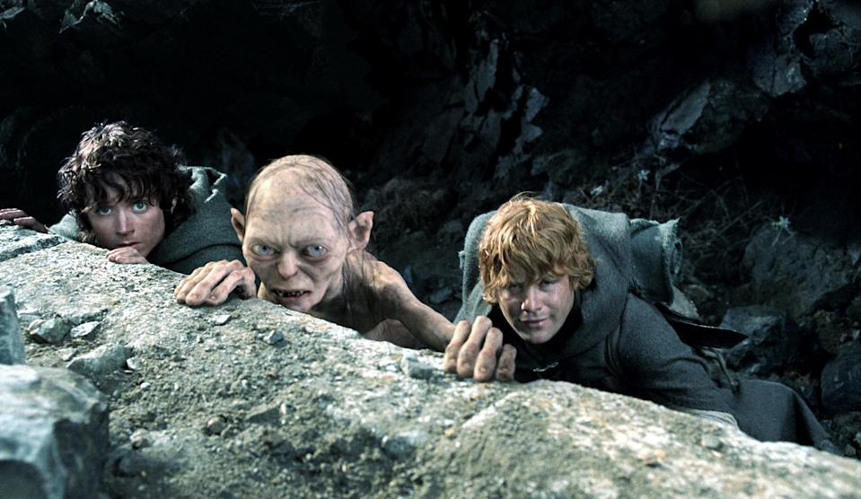 Frodo (Elijah Wood), Gollum (Andy Serkis) and Samwise (Sean Astin) take cover in <em>The Return of the King</em>. (Photo: New Line/courtesy Everett Collection)