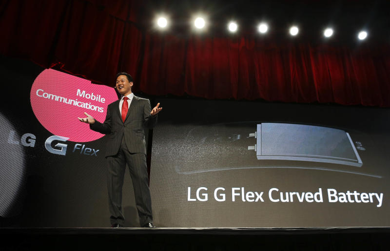 LG spokesman Frank Lee talks about the LG G Flex curved smartphone battery during the 2014 Consumer Electronics Show, Monday, Jan. 6, 2014, in Las Vegas. The phone, already available in some foreign markets, will debut in the United States in the Spring. (AP Photo/Julie Jacobson)