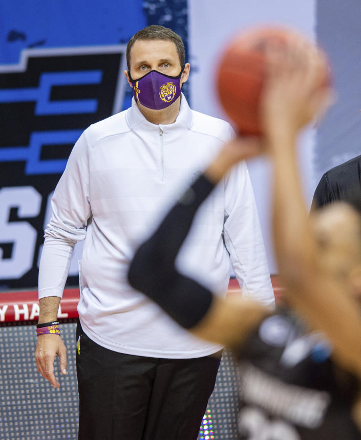 LSU head coach Will Wade watches the action on the court during the first half of a first round game against St. Bonaventure in the NCAA men's college basketball tournament, Saturday, March 20, 2021, at Assembly Hall in Bloomington, Ind. (AP Photo/Doug McSchooler)