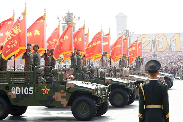 Troops in military vehicles take part in the military parade marking the 70th founding anniversary of People's Republic of China, on its National Day in Beijing, China October 1, 2019. (Photo: Thomas Peter/Reuters)