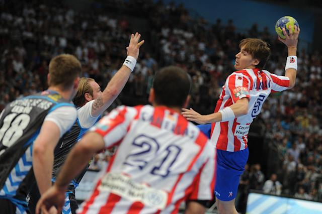 Madrid's Jonas Kaellmann (R) vies with players of Copenhagen during the Handball Champions League EHF Final Four semi final match BM Atletico Madrid vs AG Kobenhavn on May 26, 2012 in Cologne, western Germany. AFP PHOTO JONAS GUETTLER GERMANY OUTJONAS GUETTLER/AFP/GettyImages