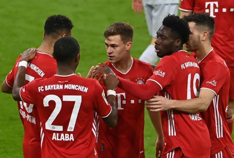 Bayern Munich midfielder Joshua Kimmich (C) celebrates scoring in Tuesday's 2-0 win at home to Bayer Leverkusen