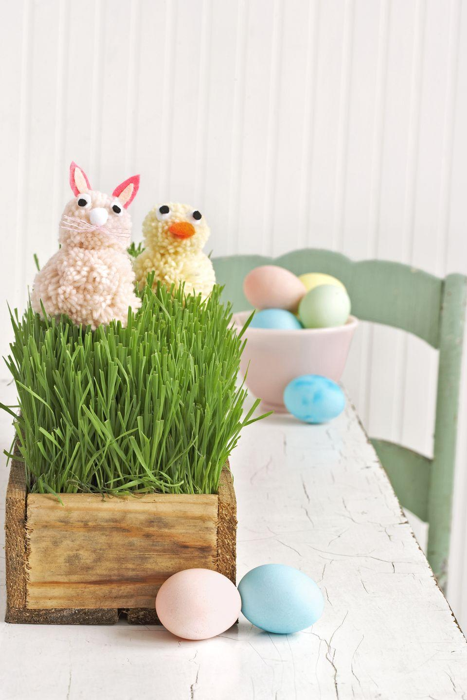 "<p>To create this spring chicken—and bunny—hot-glue two pom-poms together, using the smaller tool to make the head and the larger for the body. From craft felt, cut out small black and white circles for the eyes and pink petal shapes in two sizes for the bunny's ears. Use <a href=""https://www.amazon.com/dp/B004O9S98S/ref=asc_df_B004O9S98S5347596"" rel=""nofollow noopener"" target=""_blank"" data-ylk=""slk:premade mini pom-poms"" class=""link rapid-noclick-resp"">premade mini pom-poms</a> for the nose and beak (just trim the orange pom-pom into an oval shape). Separate a one-inch length of <a href=""https://www.amazon.com/Premium-Rainbow-Color-Embroidery-Floss/dp/B016HUI756"" rel=""nofollow noopener"" target=""_blank"" data-ylk=""slk:embroidery floss"" class=""link rapid-noclick-resp"">embroidery floss</a> into strands, and knot it in the middle for bunny whiskers. Adhere everything with little dabs of hot glue (place the smaller items with tweezers), then nestle the completed figures in a box filled with wheatgrass—found at most farmers' markets and florists.</p><p><strong>RELATED:</strong> <a href=""https://www.countryliving.com/diy-crafts/how-to/g754/diy-pom-pom-0409/"" rel=""nofollow noopener"" target=""_blank"" data-ylk=""slk:How to Make a Pom-Pom in 5 Minutes"" class=""link rapid-noclick-resp"">How to Make a Pom-Pom in 5 Minutes</a></p>"