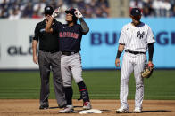 Cleveland Indians' Yu Chang, left, celebrates after hitting a two-run double off New York Yankees relief pitcher Albert Abreu in the fifth inning of a baseball game, Saturday, Sept. 18, 2021, in New York. (AP Photo/John Minchillo)