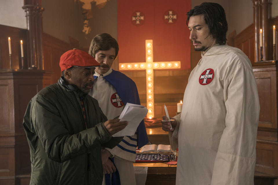 "This image released by Focus Features shows director Spike Lee, left, with actors Topher Grace, center, and Adam Driver on the set of Lee's film ""BlacKkKlansman."" (David Lee/Focus Features via AP)"