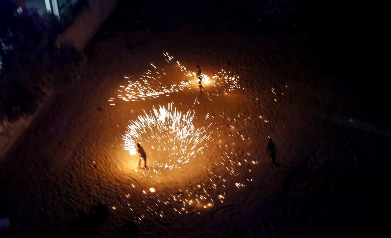<p>A Palestinian boy plays with fireworks as he celebrates the start Ramadan in Gaza City, June 7, 2016. Ramadan is traditionally a time of reflection and prayer, and Muslims focus on spirituality, good deeds and charity. (AP/Hatem Moussa) </p>