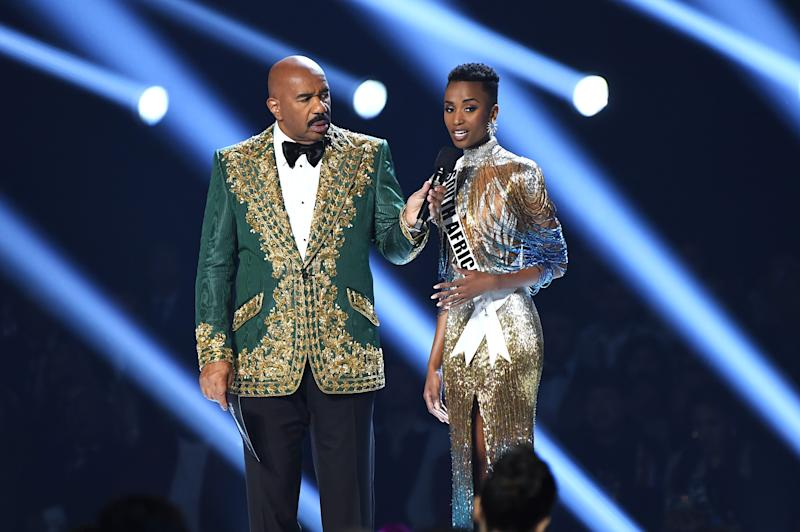 Steve Harvey and Miss South Africa Zozibini Tunzi speak onstage at the 2019 Miss Universe Pageant at Tyler Perry Studios on Dec. 8, 2019 in Atlanta, Georgia.
