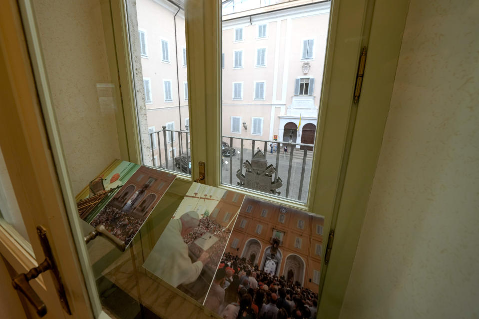 Photos of Pope John Paul II are displayed at the balcony window from where he used to hold general audiences during his stay at the Papal Palace in Castel Gandolfo, some 30 kilometers southeast of Rome, Saturday, May 29, 2021. As Covid-19 restrictions are slowly being lifted in Italy, thousands of people are returning to visit the extensive gardens and apartments at the Papal Palace of Castel Gandolfo in the Alban Hills near Rome, that for hundreds of years have been the summer retreat for Popes seeking to escape the suffocating heat of Rome. (AP Photo/Andrew Medichini)