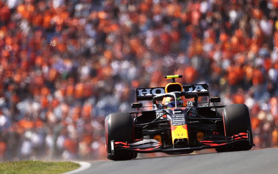 Sergio Perez of Mexico driving the (11) Red Bull Racing RB16B Honda on their way to the grid prior to the F1 Grand Prix of The Netherlands at Circuit Zandvoort on September 05, 2021 in Zandvoort, Netherland - Lars Baron/Getty Images